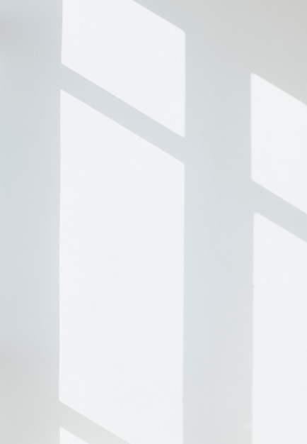 Shadow of a window on a white wall Free Psd