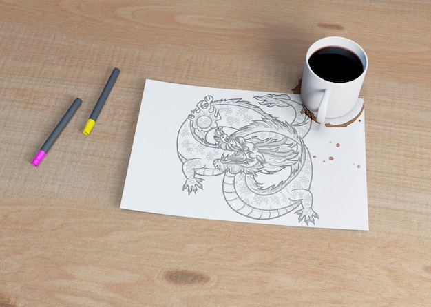 Sheet with sketch and cup of coffee beside Free Psd
