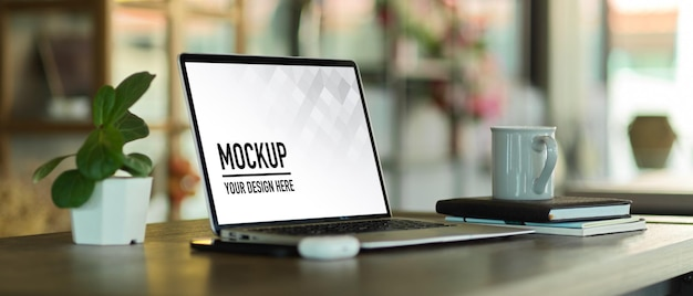 Side view of portable workspace with laptop mockup Premium Psd