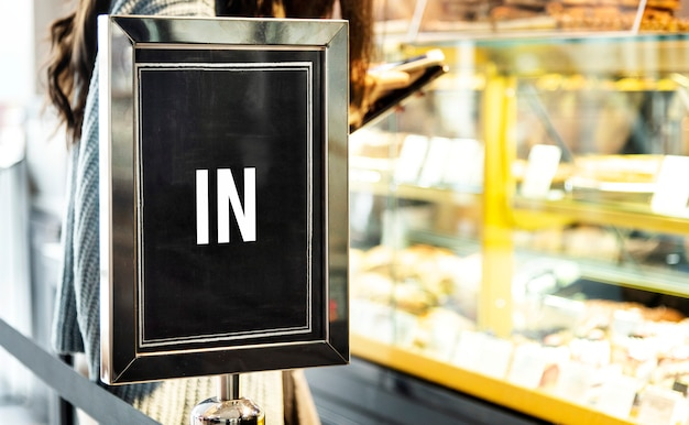 In sign mockup at the front of a cafe Free Psd