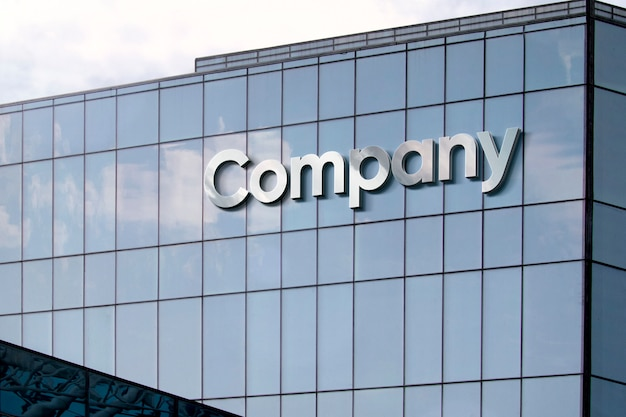 Silver letters on glass building facade Free Psd