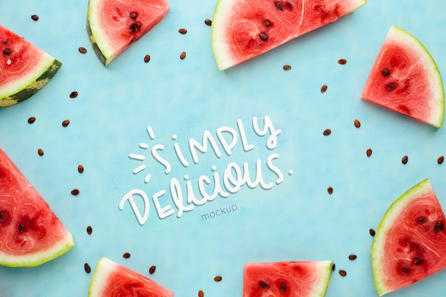 Simply delicious mock-up surrounded by slices of watermelon frame Free Psd