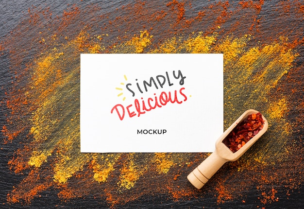 Simply delicious mock-up with red and golden spices Free Psd