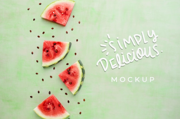 Simply delicious mock-up with slices of watermelon Free Psd