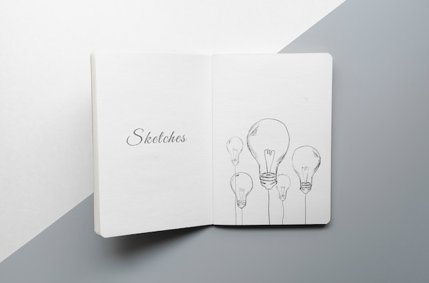 Sketch book on bicolored background Free Psd