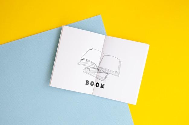Эскиз книги макет на двухцветном фоне Бесплатные Psd