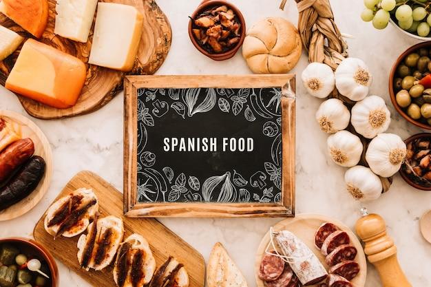 Slate mockup with traditional spanish food Free Psd