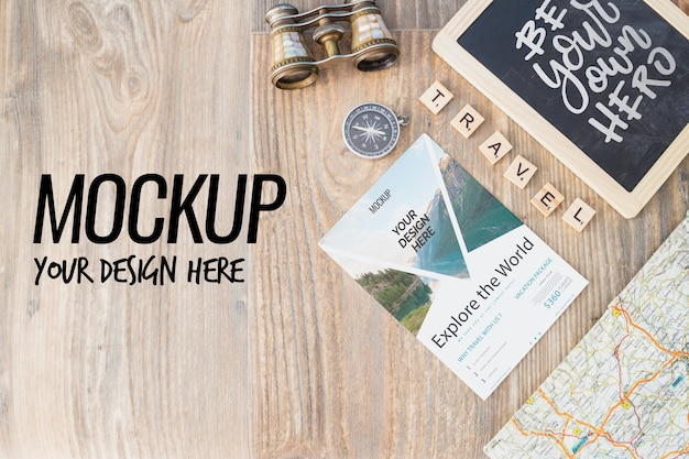 Slate mockup with travel elements Free Psd