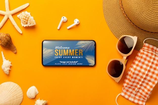 Smartphone mockup and beach accessories, mask Premium Psd