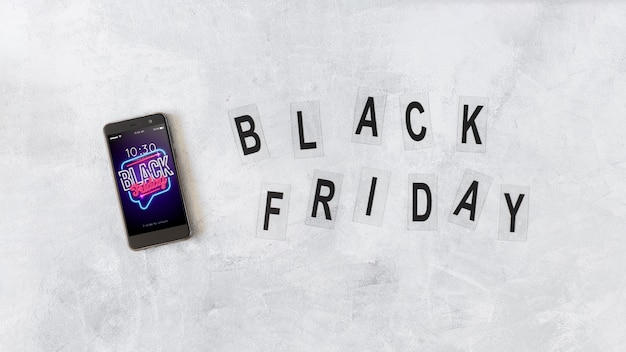 Smartphone mockup and black friday letters Free Psd