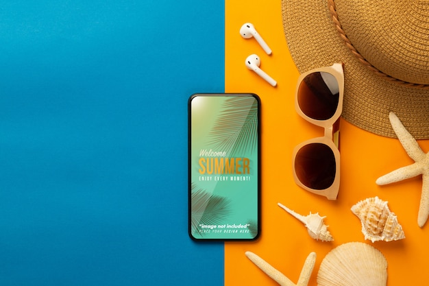 Smartphone mockup screen with beach accessories and earphones, top view Premium Psd