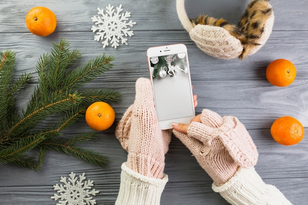 Smartphone mockup with christmas decoration Free Psd
