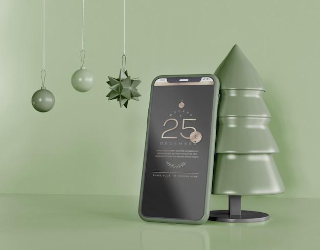 Smartphone mockup with christmas decoration Premium Psd
