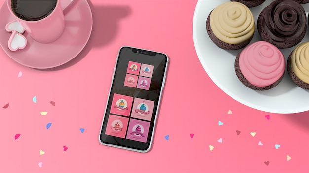 Smartphone mockup with cupcakes Free Psd