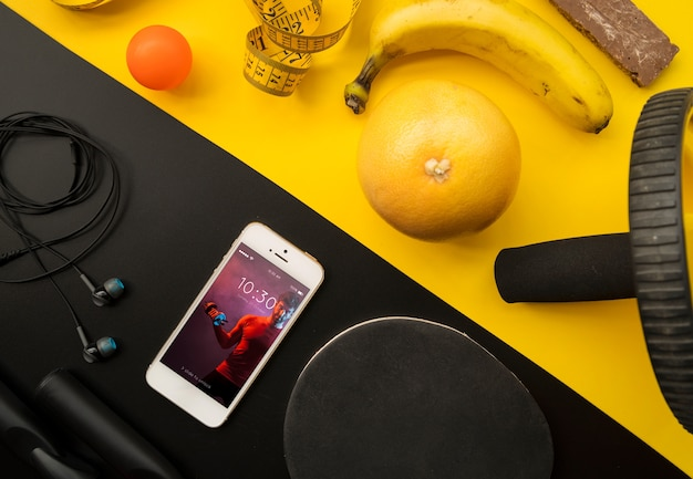 Smartphone mockup with fitness concept Free Psd