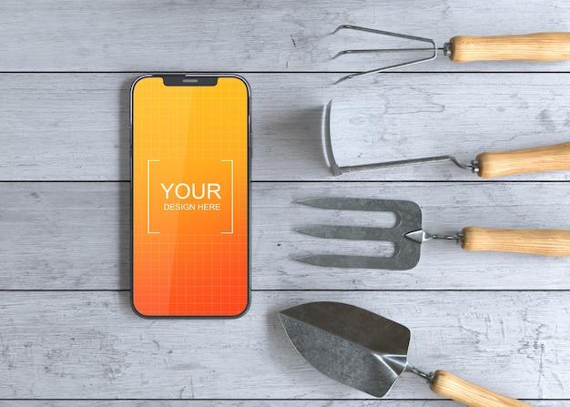 ガーデニングツールを備えたスマートフォンのモックアップ Premium Psd