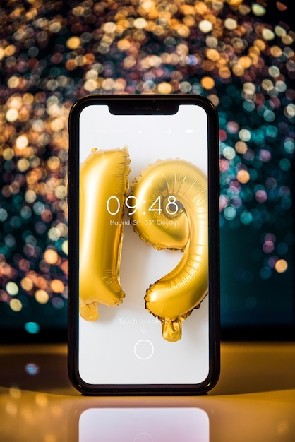 Smartphone mockup with new year decoration Free Psd
