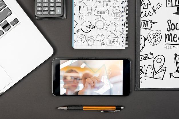Smartphone mockup on workspace Free Psd