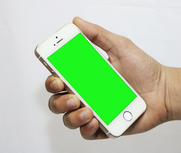 Smartphone with green screen in hand Free Psd