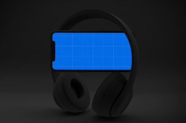 Смартфон с экраном и наушниками, музыкальная концепция приложения Premium Psd