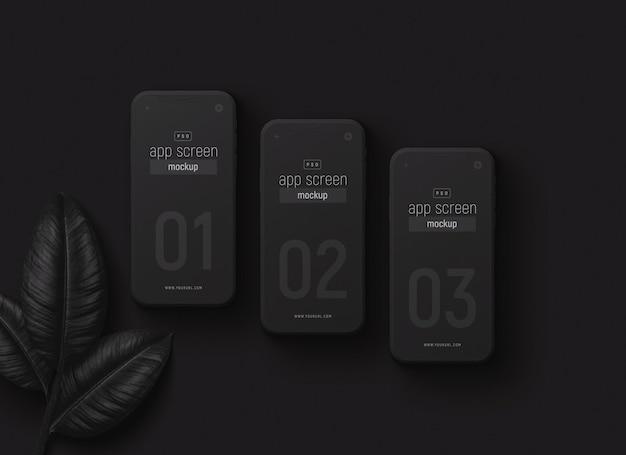 Smartphones set mockup with black leaves Premium Psd