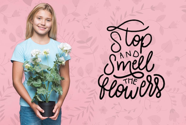 Smell the flowers cute young girl Free Psd