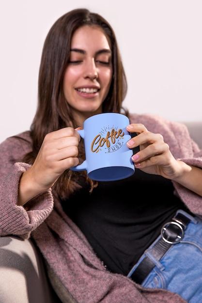 Smiley woman holding mug Free Psd
