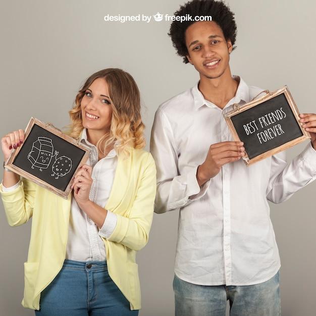 Smiling couple holding slates Free Psd
