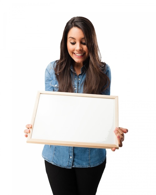 Smiling student looking at a blank board Free Psd