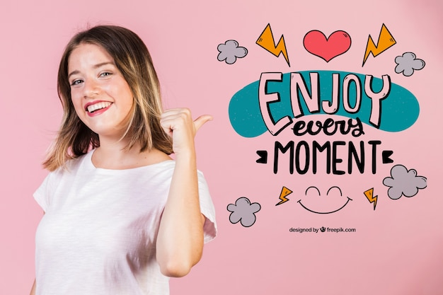 Smiling young woman pointing a positive quote Free Psd
