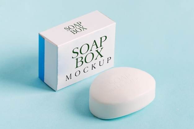 Soap wrap box mock-up package and bar soap isolated on blue background Premium Psd