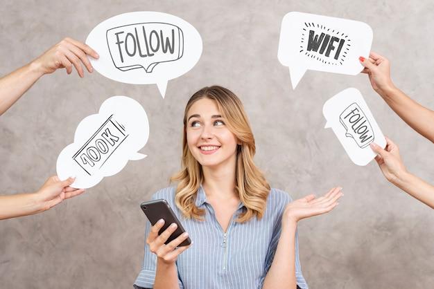 Social media speech bubbles surrounding a woman Free Psd