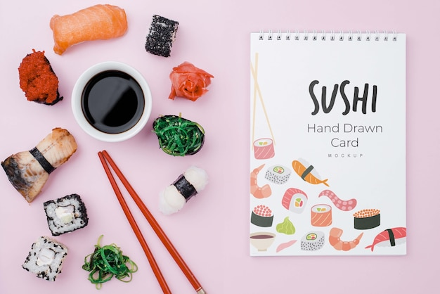 Soya sauce and sushi rolls with notebook Free Psd