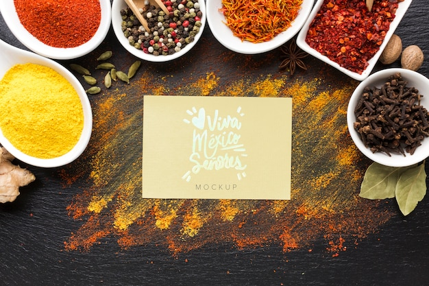 Spices and herbs mock-up with viva mexico card top view Free Psd