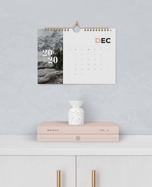 Spiral book link for calendar pinned on wall Free Psd