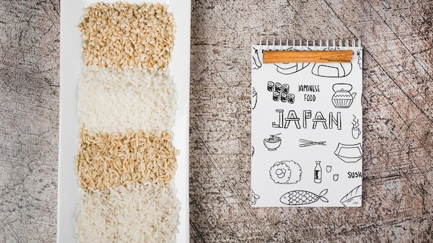 Spiral notepad mockup with japanese food mockup Free Psd