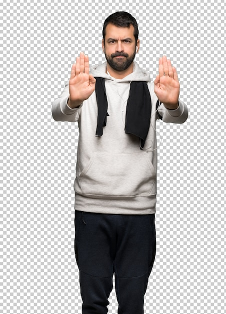 Sport man making stop gesture for disappointed with an opinion Premium Psd