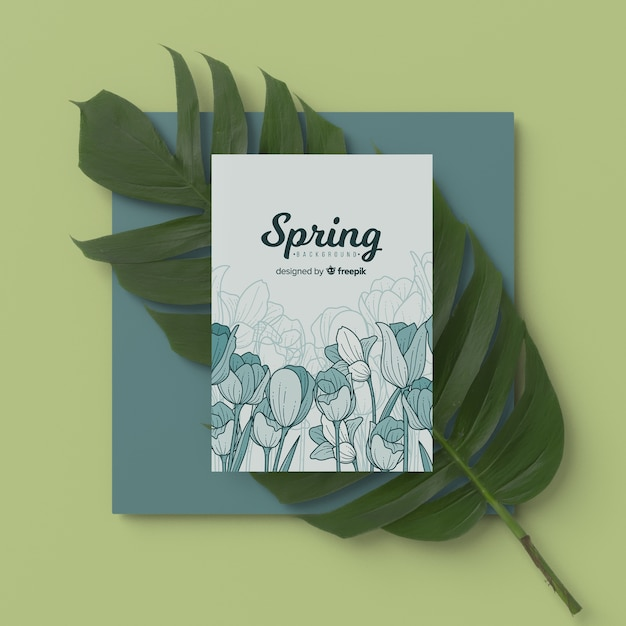 Spring card with 3d leaf on table Free Psd