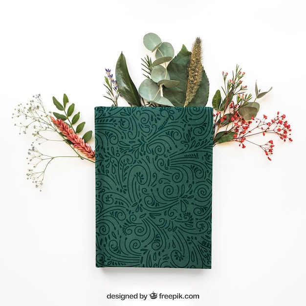 Spring concept mockup with book on leaves Free Psd