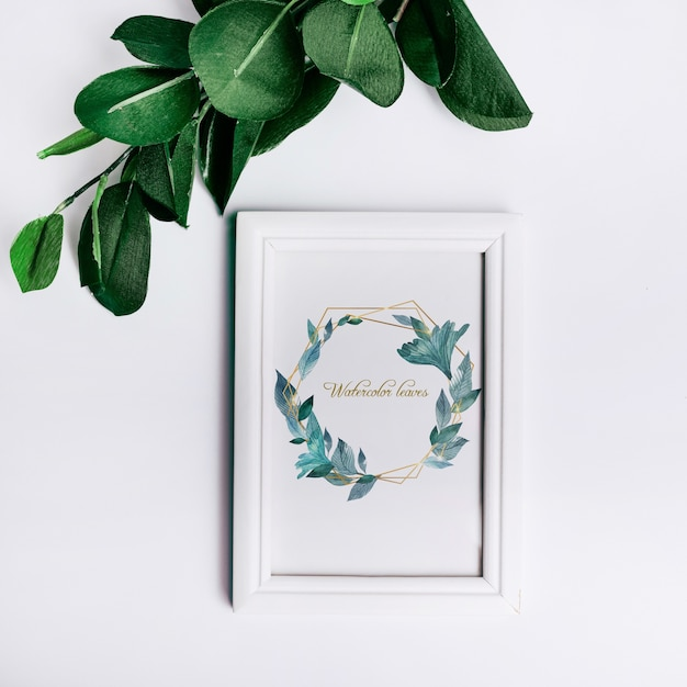 Spring frame mockup with decorative leaves in top view Free Psd
