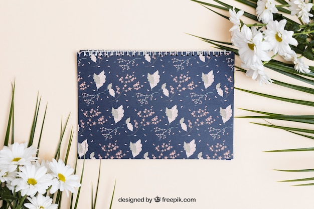 Spring mockup with spiral notebook Free Psd