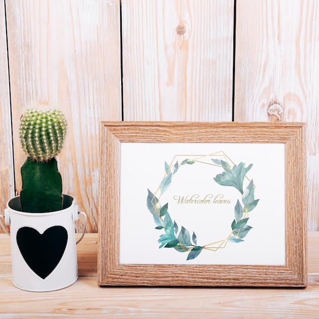 Spring mockup with wooden frame and cactus Free Psd