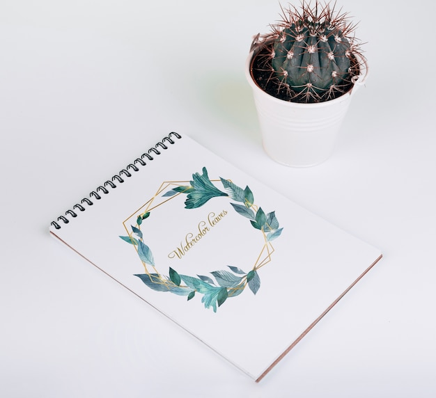 Spring notebook mockup with decorative cactus Free Psd