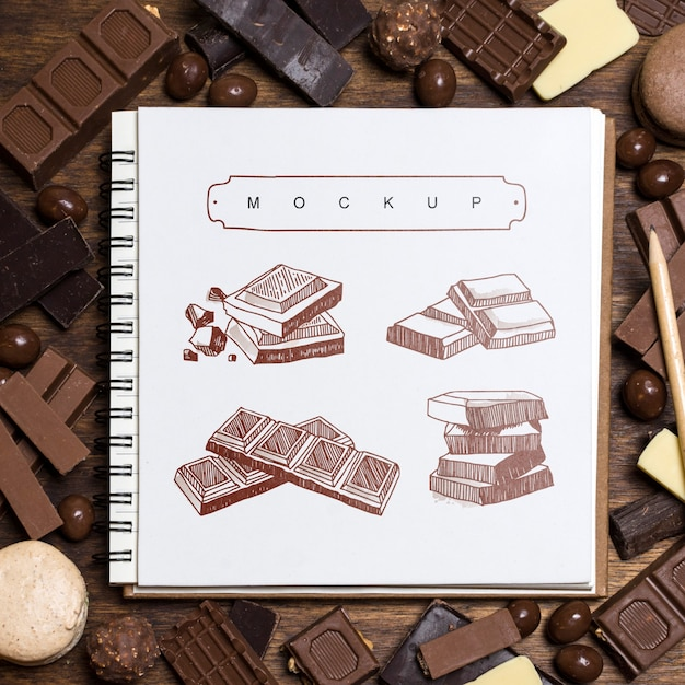 Square booklet mockup on chocolate background Free Psd