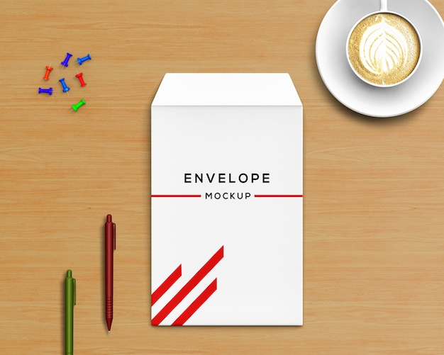 Stationery concept with envelope mockup and coffee Free Psd