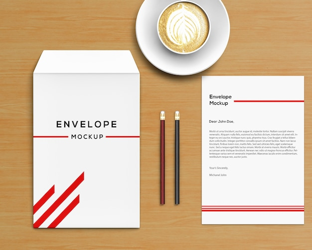 Stationery concept with envelope mockup and coffee Premium Psd