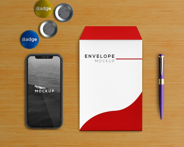 Stationery concept with envelope and smartphone mockup Free Psd