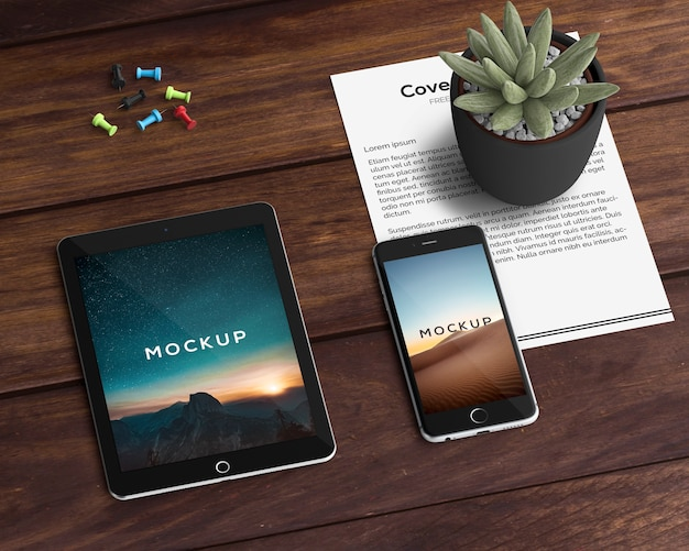 Stationery concept with tablet and smartphone mockup Free Psd