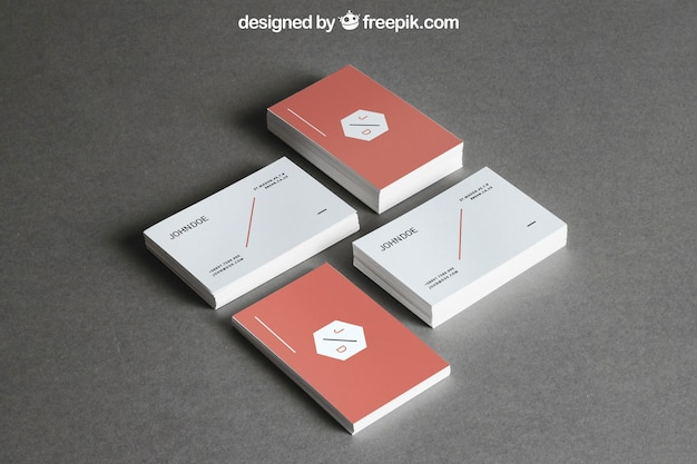 Stationery mockup with four stacks of business cards Free Psd