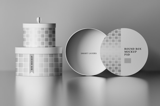 Stationery mockup with round packaging boxes with editable labels over shiny surface Premium Psd